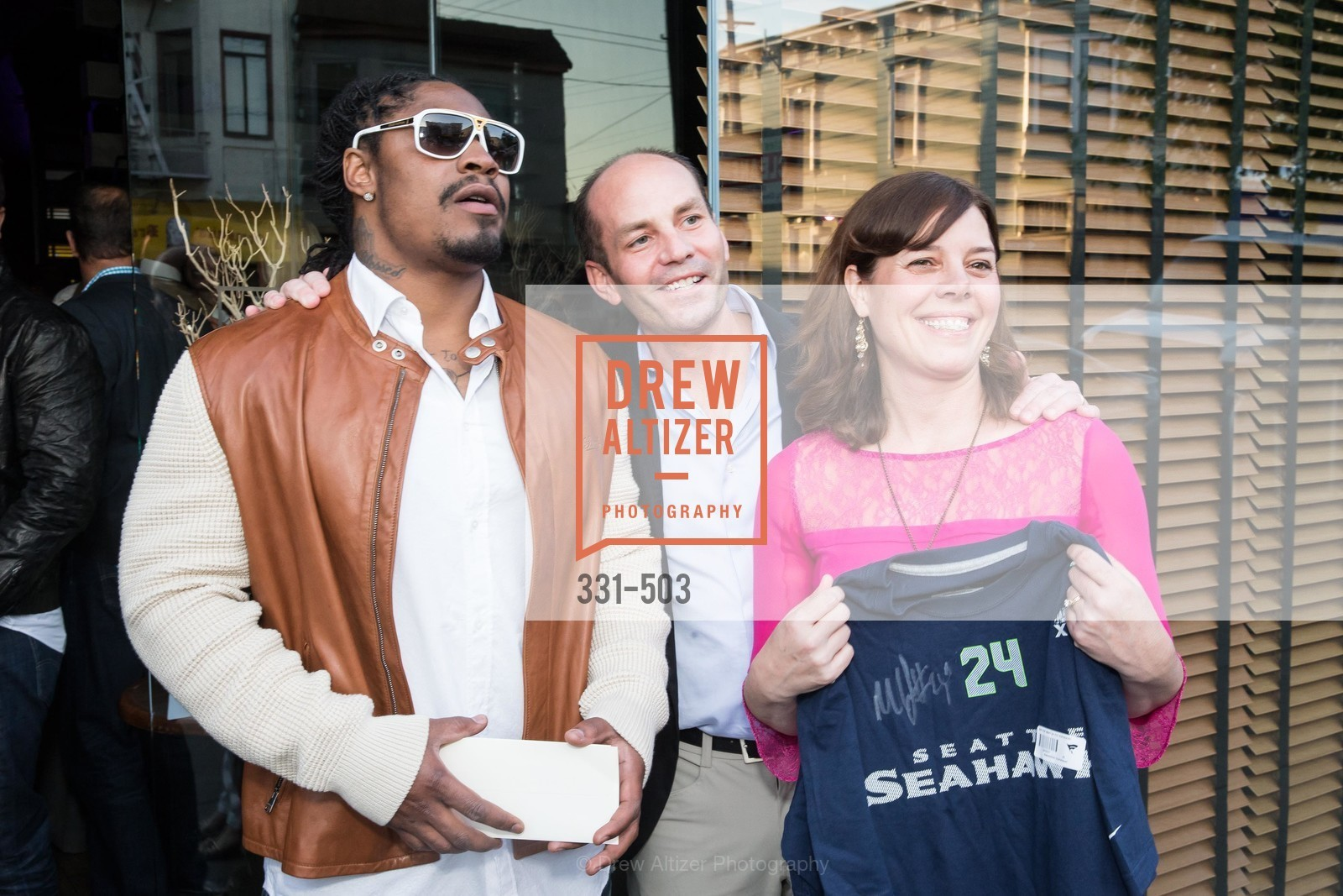 Marshawn Lynch, Greg Roberts, Lynne Roberts, NFL CELEBRITY Bartending Event, US. US, April 7th, 2014,Drew Altizer, Drew Altizer Photography, full-service agency, private events, San Francisco photographer, photographer california