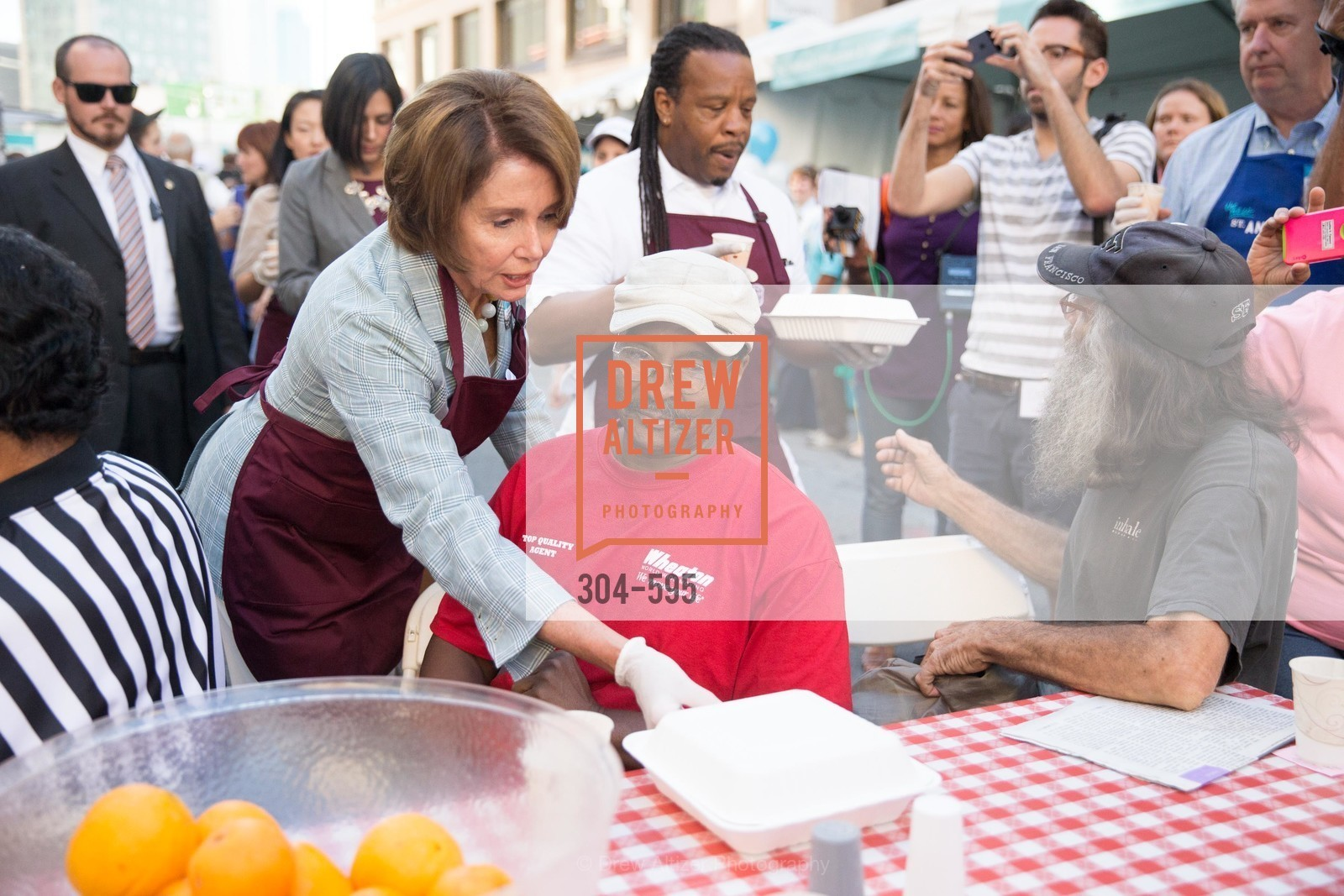 The Honorable Nancy Pelosi, Tyrone Hopper, ST. ANTHONY'S Dining Room Ribbon Cutting Ceremony, US, October 4th, 2014,Drew Altizer, Drew Altizer Photography, full-service agency, private events, San Francisco photographer, photographer california