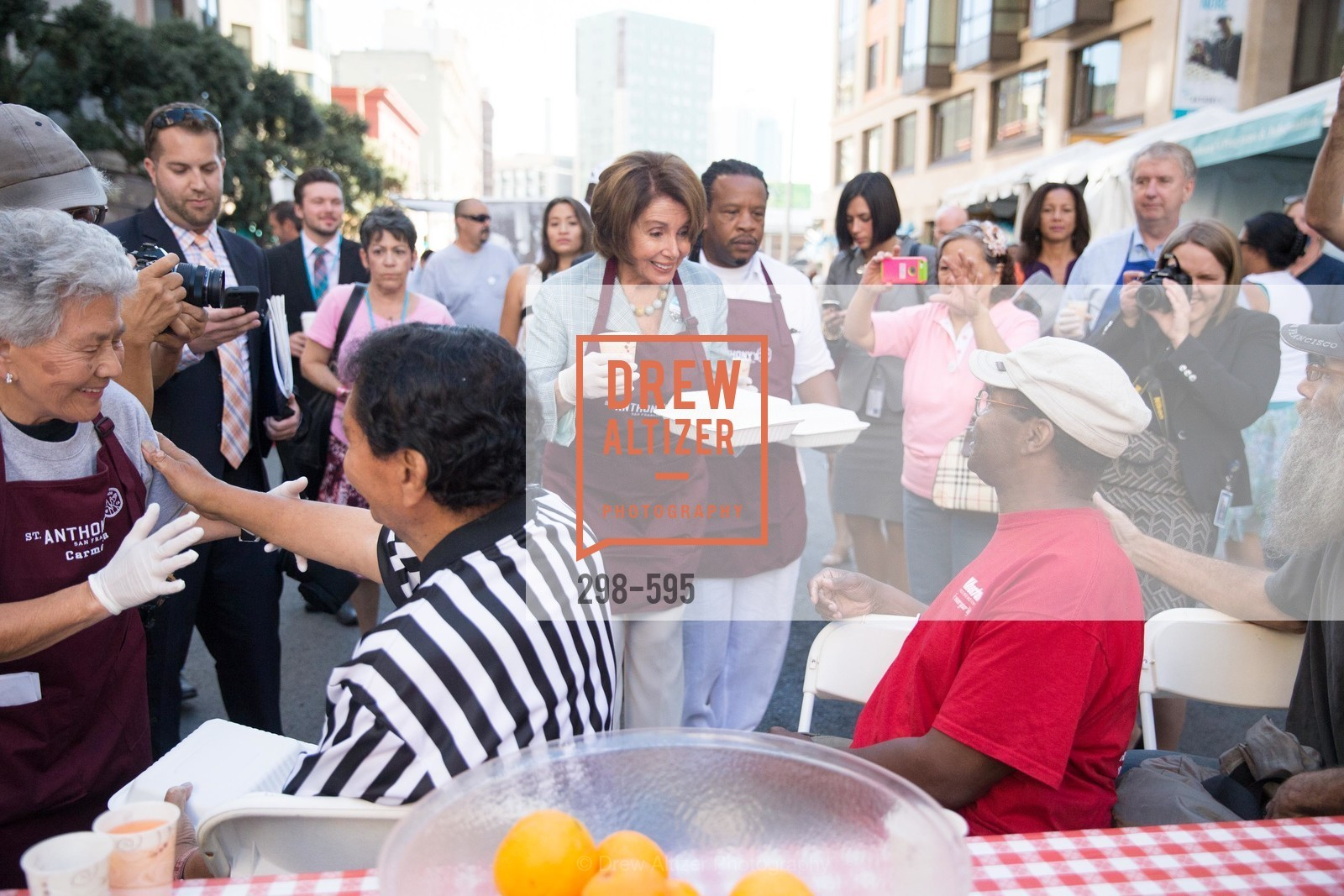 Carmelita Lozano, The Honorable Nancy Pelosi, Tyrone Hopper, ST. ANTHONY'S Dining Room Ribbon Cutting Ceremony, US, October 4th, 2014,Drew Altizer, Drew Altizer Photography, full-service agency, private events, San Francisco photographer, photographer california