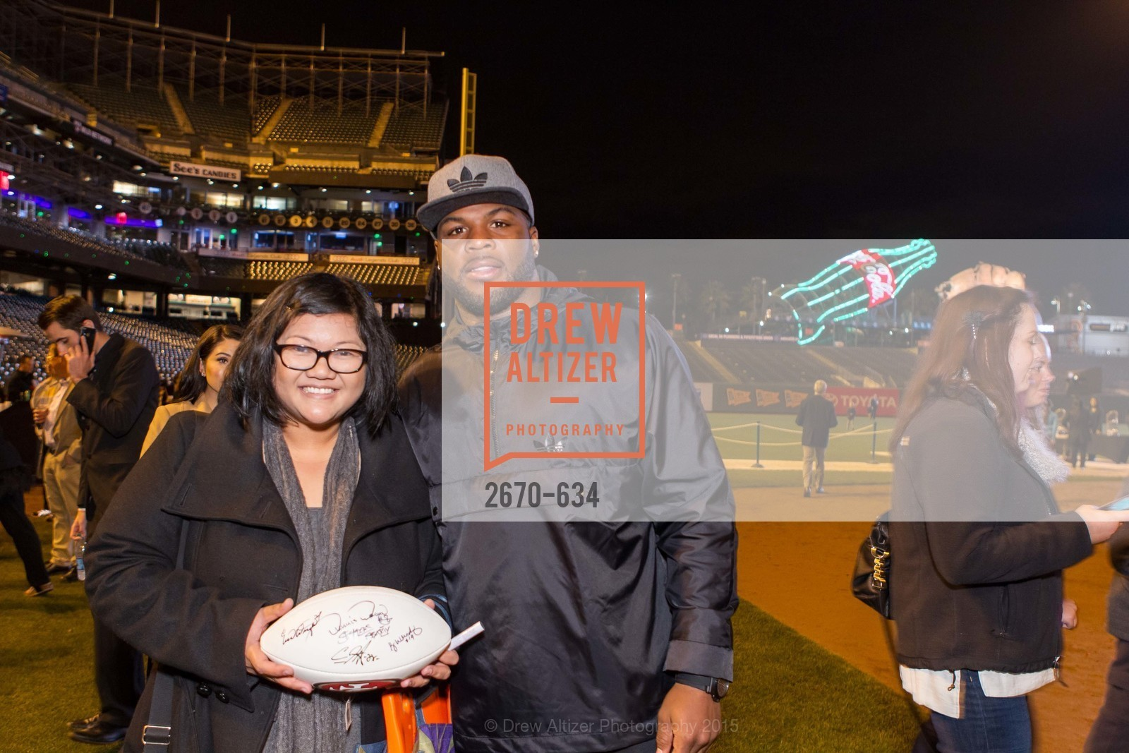 Cindy Enriquez, Carlos Hyde, Holiday Heroes 2015, AT&T Park, December 7th, 2015,Drew Altizer, Drew Altizer Photography, full-service event agency, private events, San Francisco photographer, photographer California